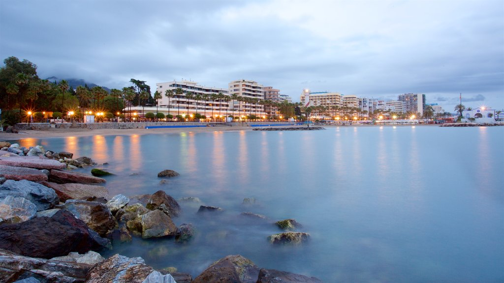 Marbella featuring general coastal views, a coastal town and rugged coastline
