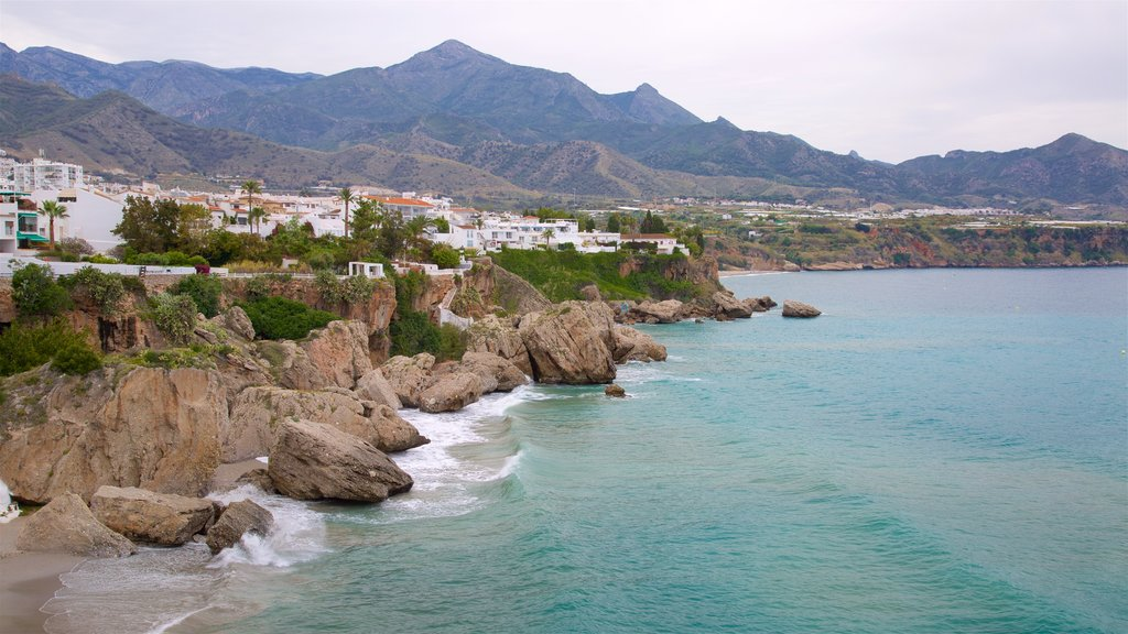 Nerja featuring mountains, rocky coastline and general coastal views