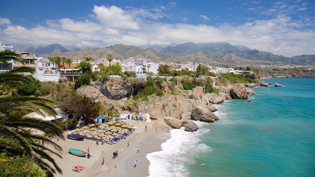 Nerja showing a sandy beach and a coastal town