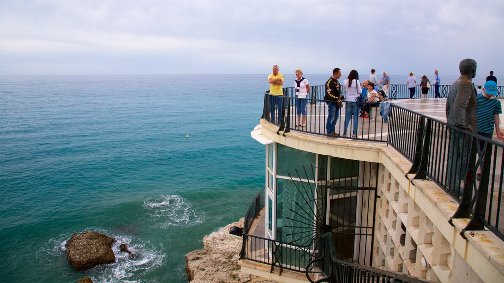 Balcon de Europa featuring views and general coastal views as well as a large group of people