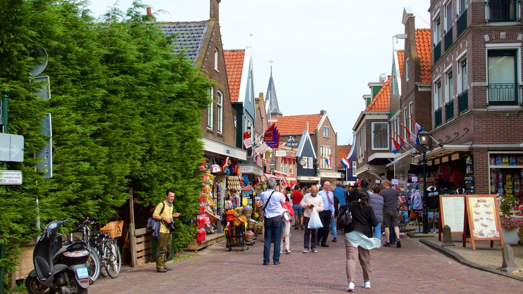 Volendam showing street scenes as well as a large group of people