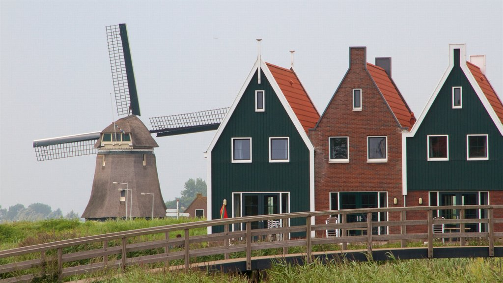 Volendam featuring farmland and a windmill
