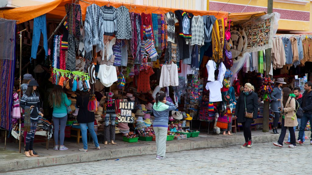 Copacabana which includes markets and street scenes as well as a large group of people