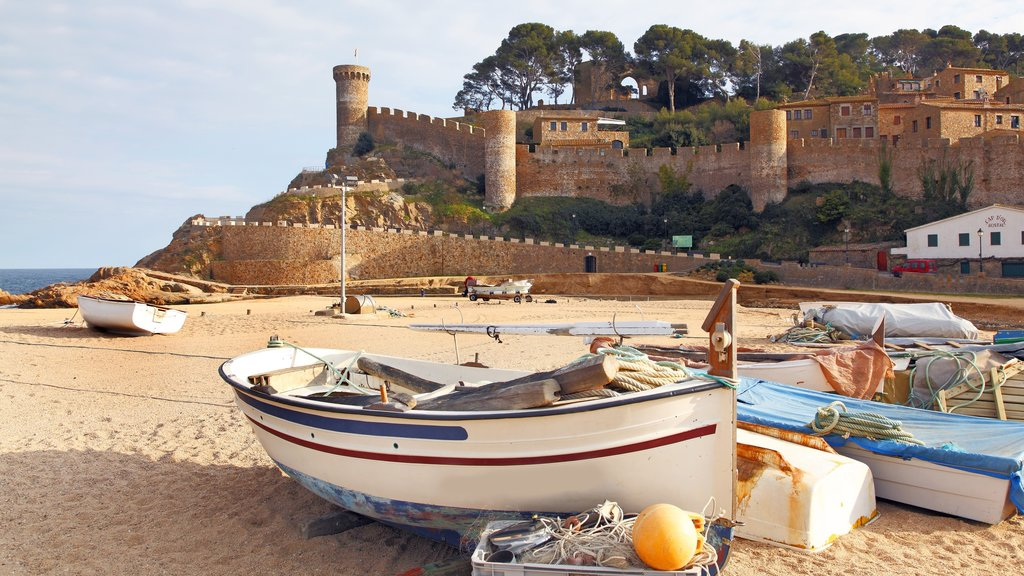 Girona which includes a sandy beach, boating and a castle