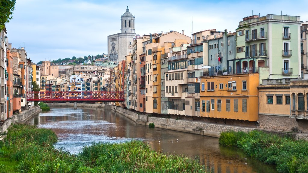 Girona which includes a small town or village and a river or creek