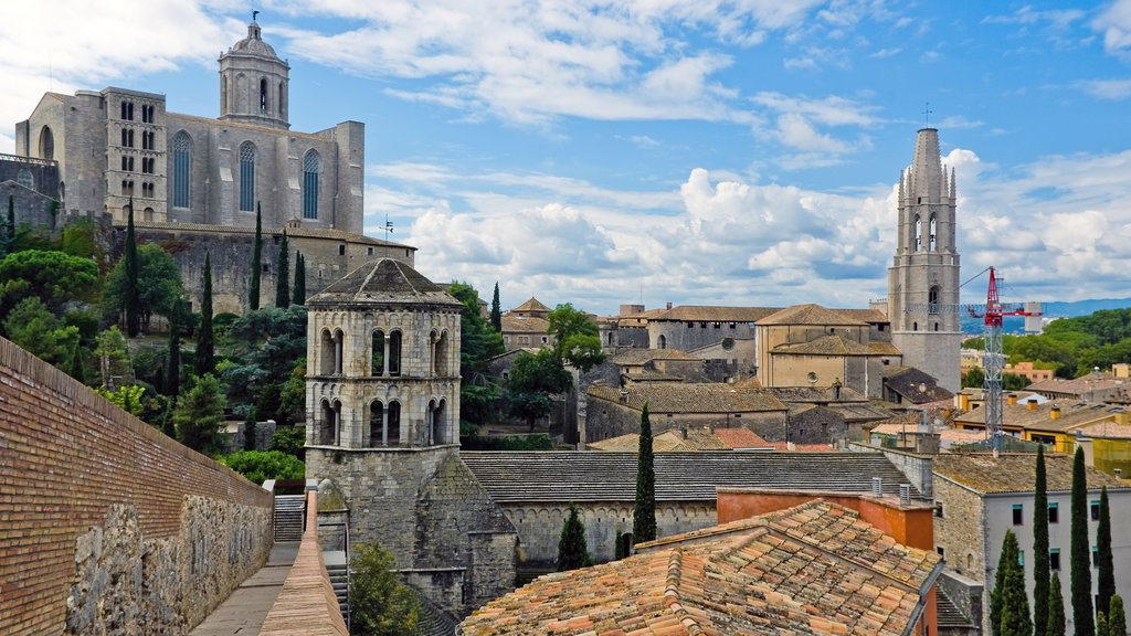 Girona which includes a small town or village and landscape views