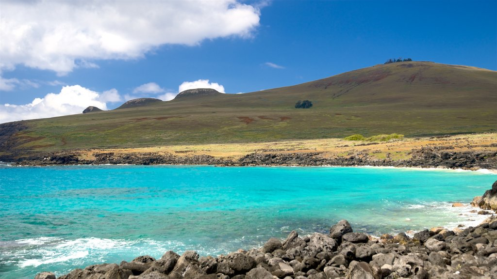 Easter Island which includes rugged coastline, mountains and general coastal views