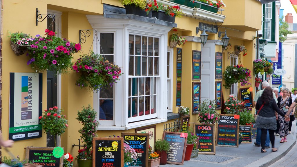 Tenby featuring flowers, markets and signage