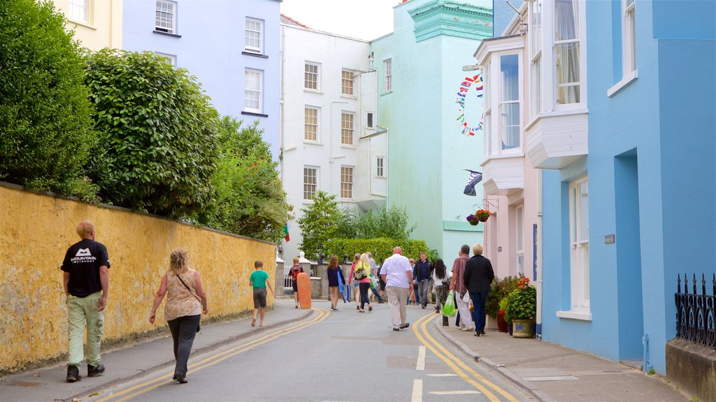 Tenby featuring a coastal town and street scenes as well as a small group of people