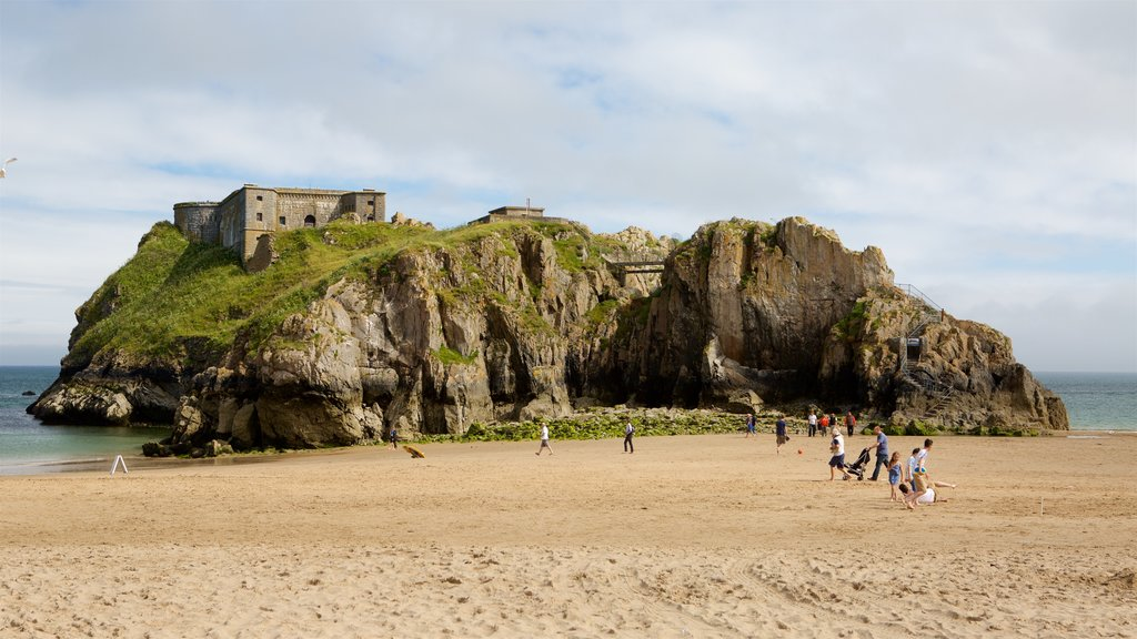 Tenby featuring chateau or palace, rocky coastline and a sandy beach