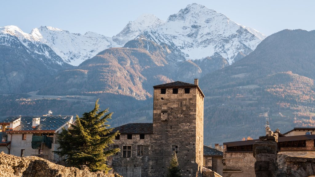 Aosta which includes mountains, a church or cathedral and heritage elements