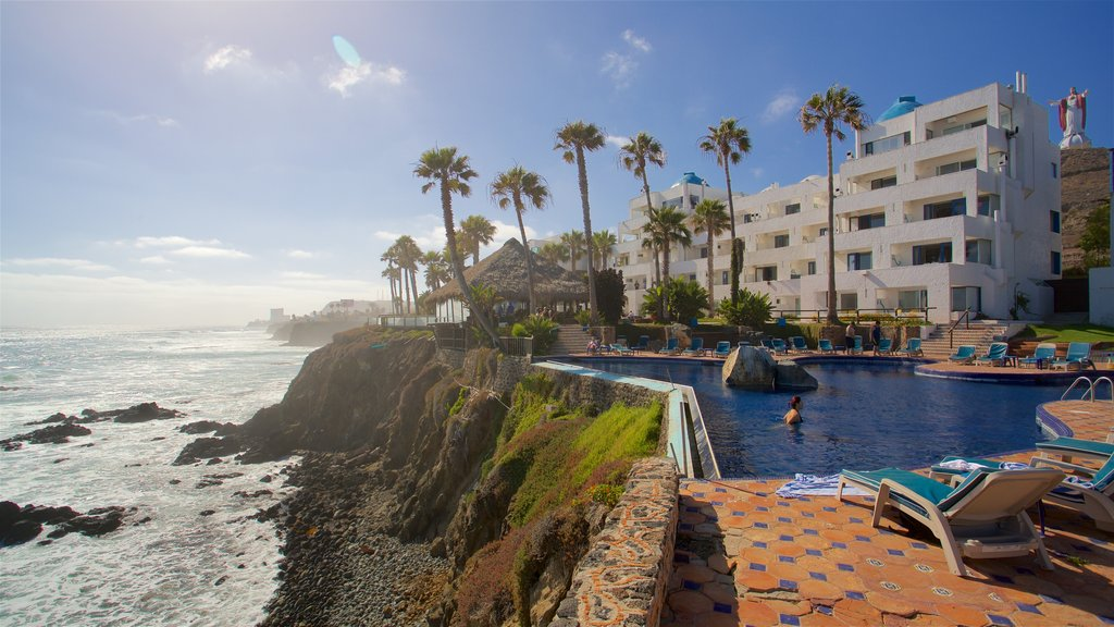 Rosarito featuring a luxury hotel or resort, rocky coastline and a pool