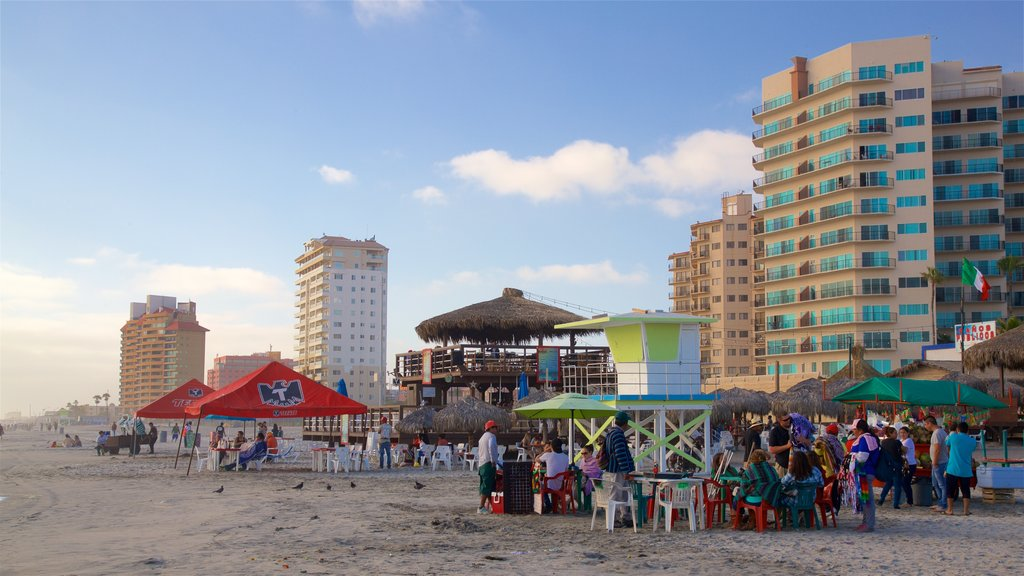 Rosarito Beach showing a beach as well as a small group of people