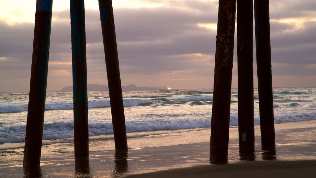 Rosarito Beach showing general coastal views, surf and a sunset