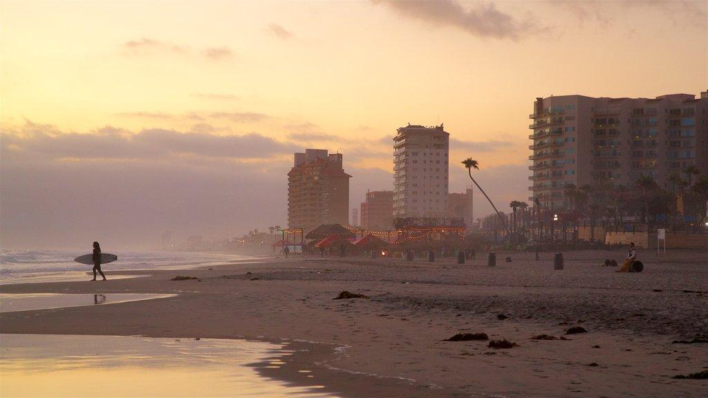 Rosarito Beach showing general coastal views, a sunset and a beach