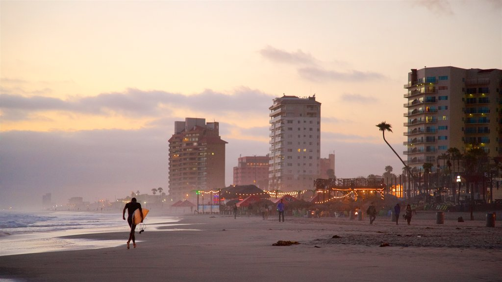 Rosarito showing a sandy beach, general coastal views and a sunset
