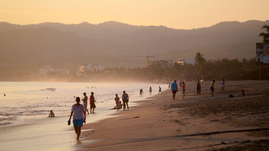 Nuevo Vallarta Beach which includes a sunset, general coastal views and a beach