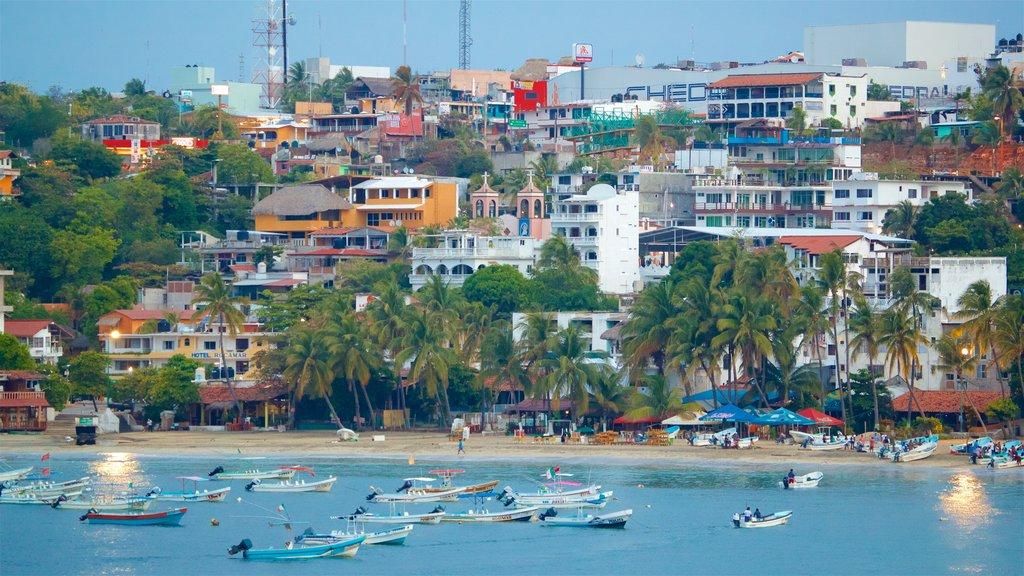 Oaxaca which includes a bay or harbor, a beach and a coastal town