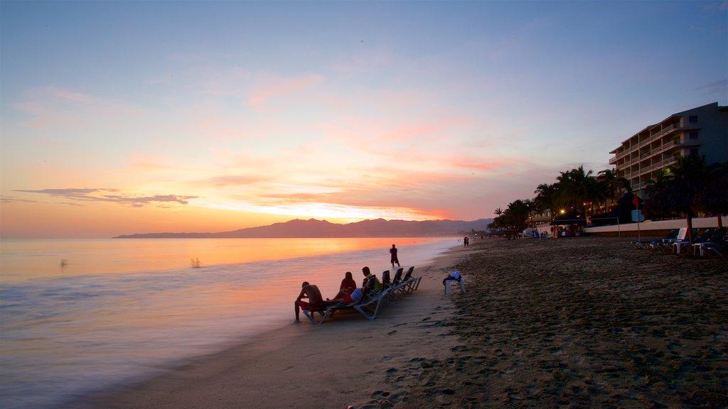 Nuevo Vallarta Beach which includes a sandy beach, a sunset and general coastal views