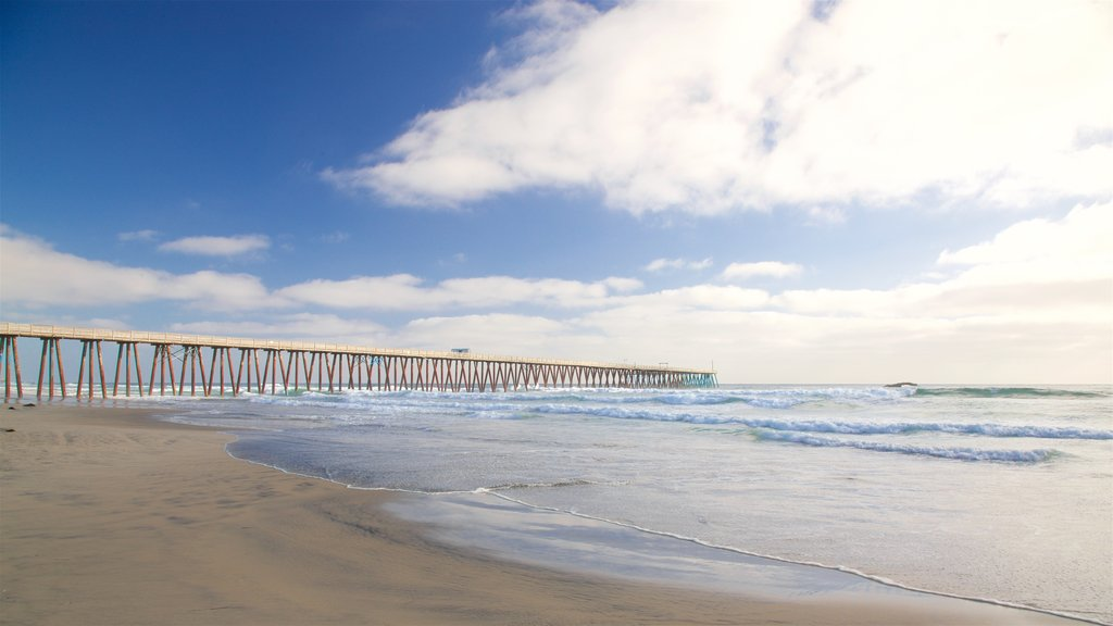 Rosarito Beach which includes waves and a beach