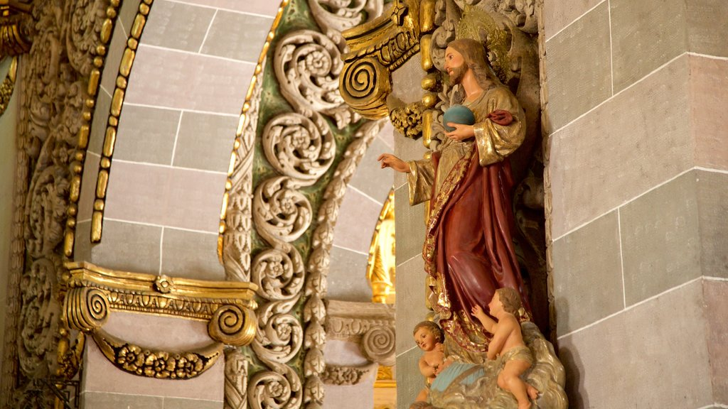 Immaculate Conception Cathedral featuring heritage architecture, a statue or sculpture and interior views