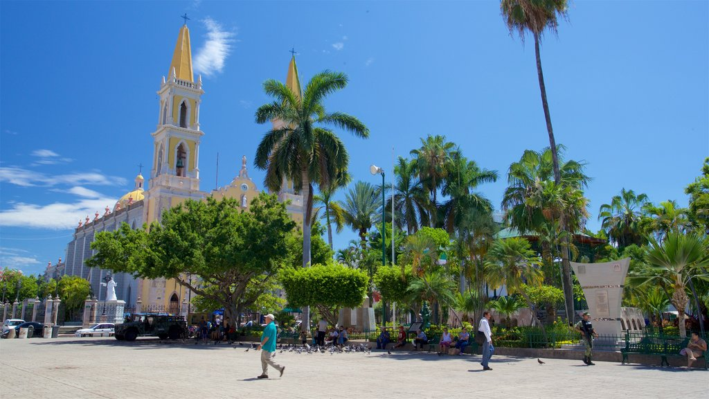 Immaculate Conception Cathedral which includes a church or cathedral and a square or plaza