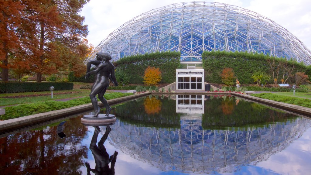 St. Louis which includes a pond, a statue or sculpture and a garden
