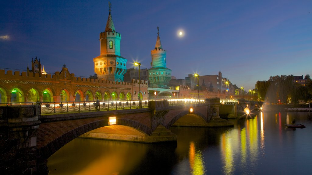Berlin which includes night scenes, a city and a river or creek