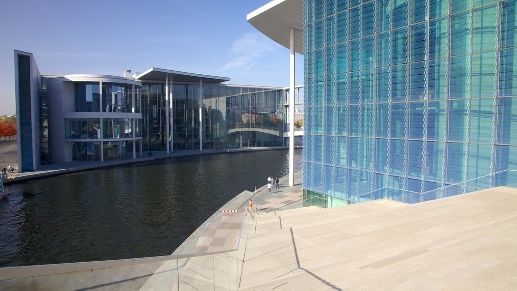 Reichstag Building which includes a pond, a city and an administrative buidling