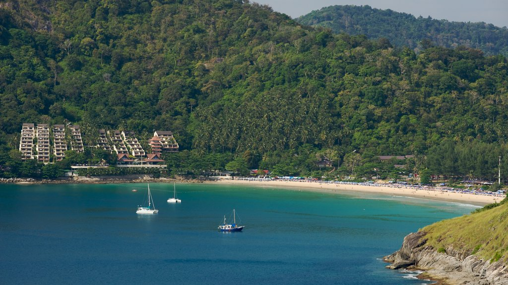 Nai Harn Beach showing boating, a coastal town and a bay or harbor