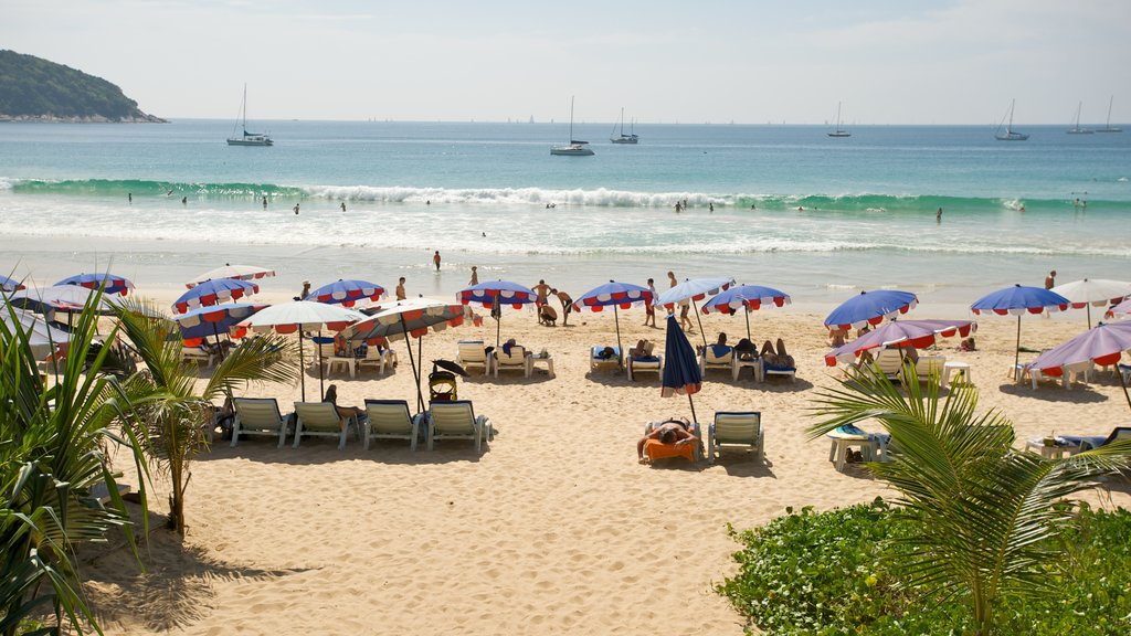 Nai Harn Beach featuring a sandy beach, landscape views and swimming