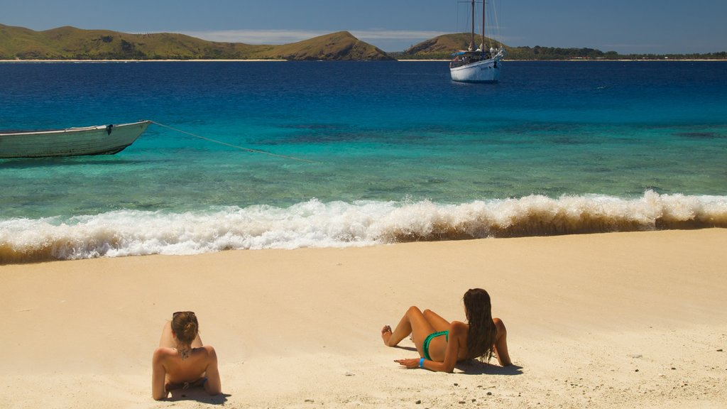 Mamanuca Islands featuring boating, a sandy beach and tropical scenes