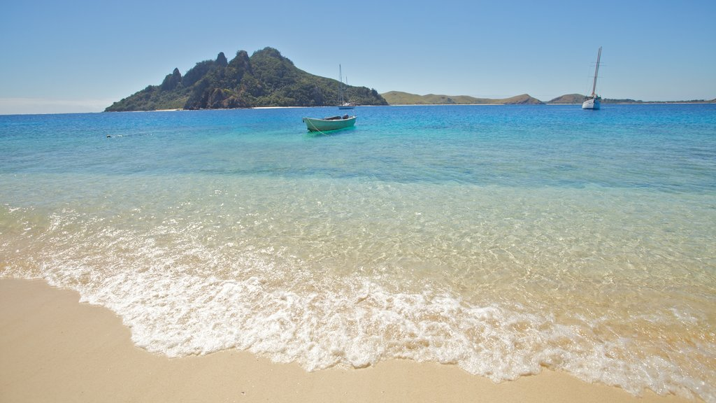 Mamanuca Islands featuring boating, a beach and tropical scenes