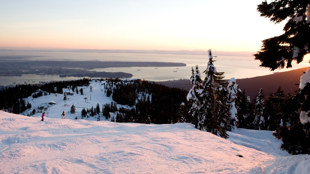Grouse Mountain which includes mountains, a sunset and landscape views