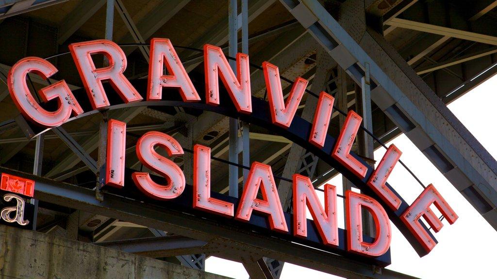 Mercado Público de la Isla Granville que incluye mercados, señalización y vistas de una isla