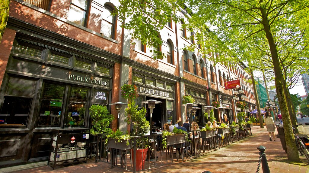 Gastown featuring a city, street scenes and cafe scenes
