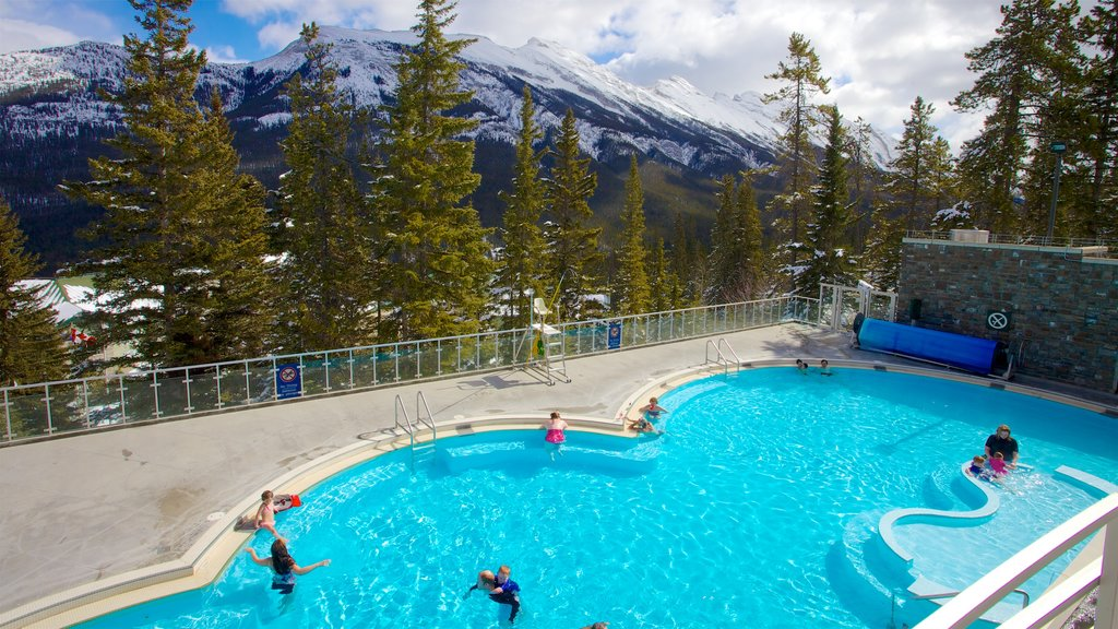 Calgary featuring a pool and tranquil scenes as well as children