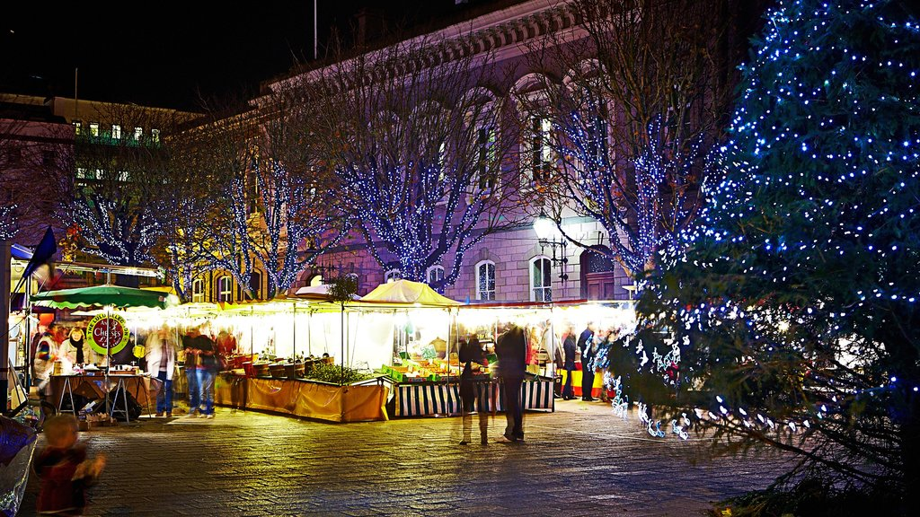 St. Helier which includes markets and night scenes