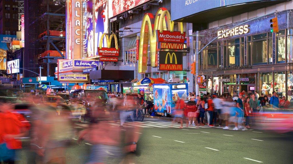 Times Square que incluye señalización, una ciudad y vistas a la ciudad