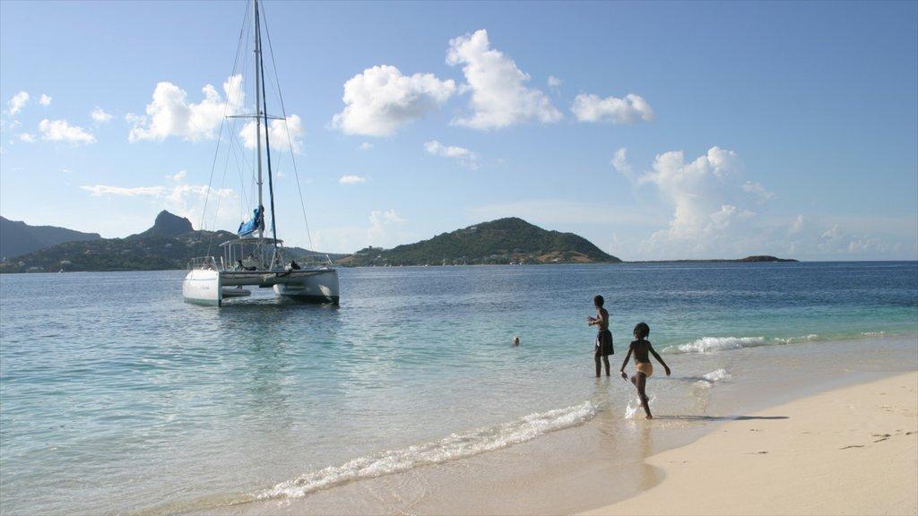 San Vicente y las Granadinas mostrando una playa y vistas generales de la costa y también niños