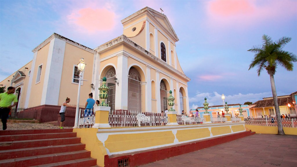 Trinidad featuring a church or cathedral, heritage elements and a sunset