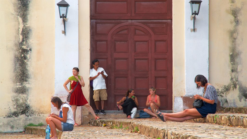 Trinidad showing heritage elements as well as a small group of people