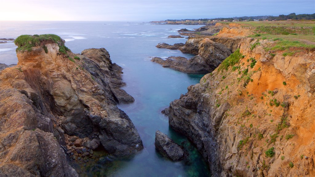 Mendocino featuring general coastal views, a sunset and rugged coastline