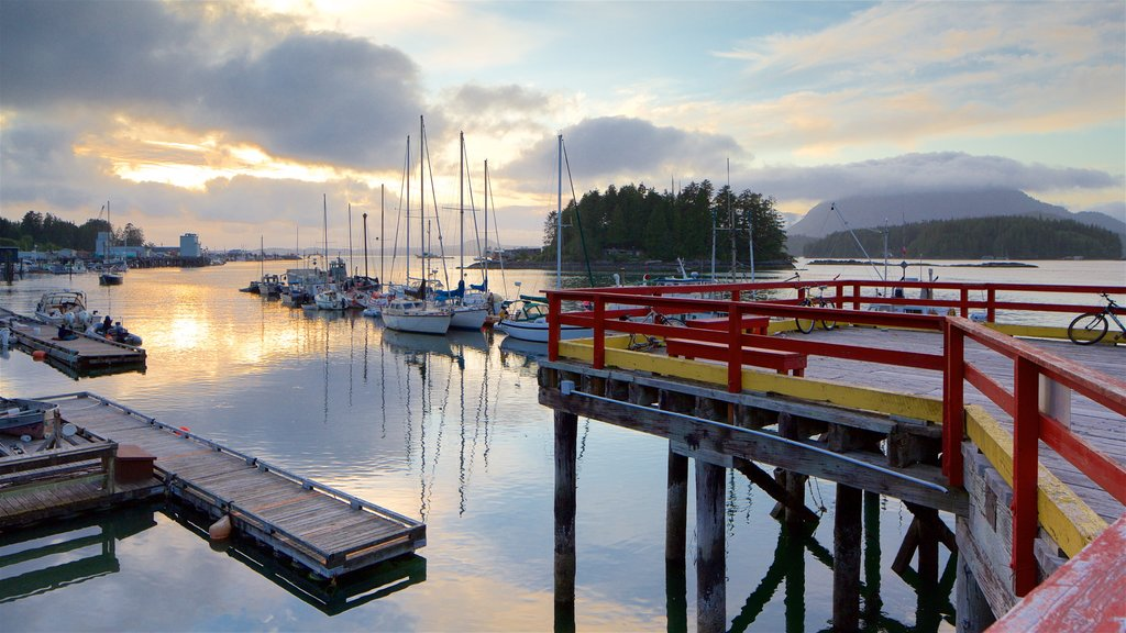 Tofino which includes a sunset, a bay or harbor and a lake or waterhole