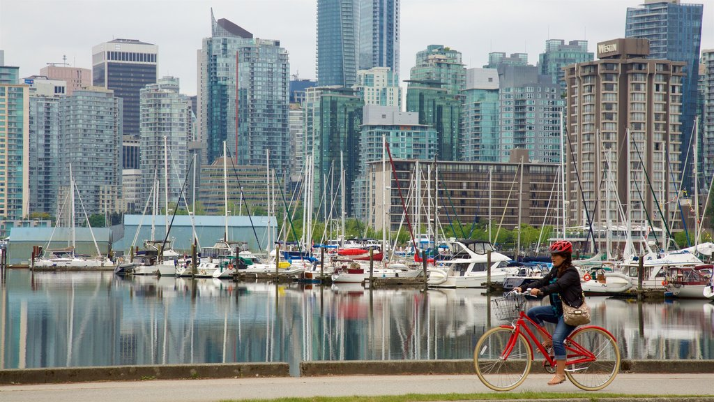 Stanley Park showing cycling, a bay or harbor and a city