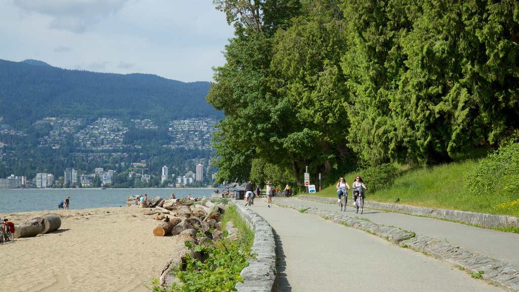 Stanley Park featuring cycling, a sandy beach and a lake or waterhole