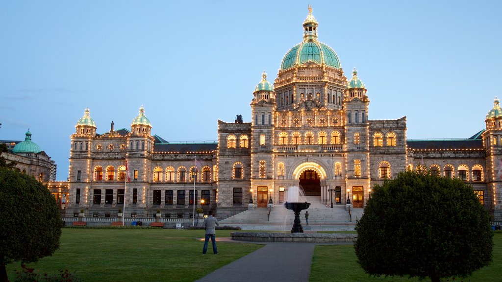 British Columbia Parliament Building featuring a garden, a fountain and night scenes