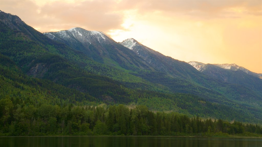 New Denver featuring tranquil scenes, a sunset and a lake or waterhole
