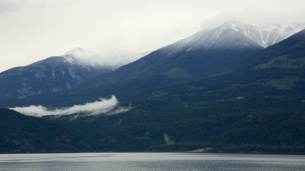 Kaslo which includes a lake or waterhole, tranquil scenes and mountains
