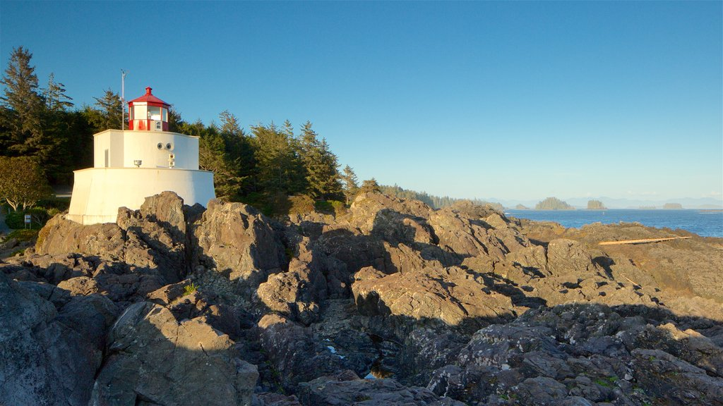 Amphitrite Point Lighthouse showing a lighthouse, a sunset and rugged coastline